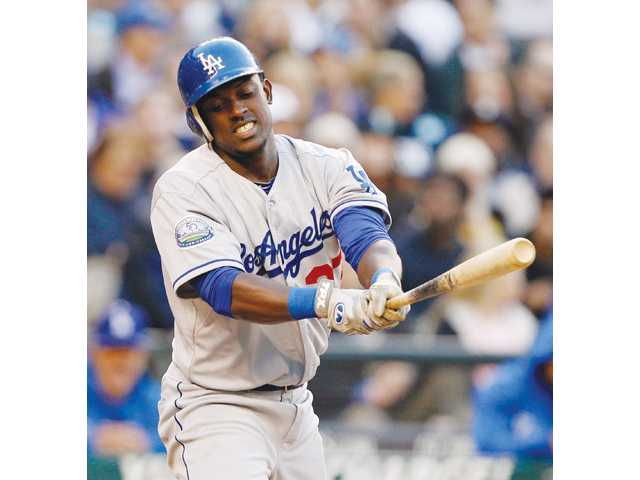 Los Angeles Dodger Elian Herrera reacts to swinging strike against the Seattle Mariners in the fourth inning on Friday in Seattle. The Dodgers lost 1-0.