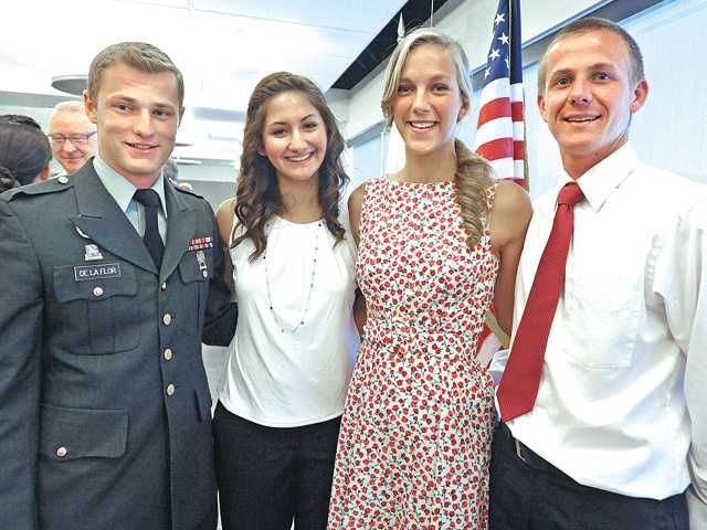 Local military academy appointees from left: Nicholas De La Flor, of Valencia; Breanne Aronin, of Acton; Ashley Welker, of Stevenson Ranch; and Sam Peckham, of Valencia, after being recognized at the 2012 Service Award Luncheon held at the Dr. Dianne G. Van Hook University Center in Valencia on Saturday.