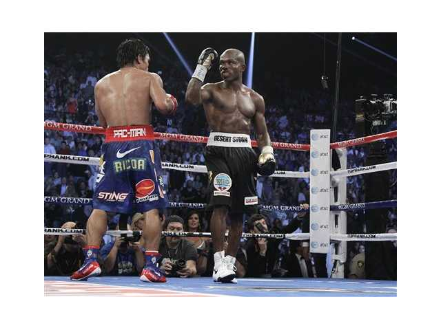 Timothy Bradley, from Palm Springs, Calif., right, and Manny Pacquiao, from the Philippines, return their corners at the end of their WBO world welterweight title fight Saturday. Bradley won the fight by decision.