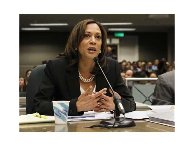 Attorney General Kamala Harris discusses her package of homeowner mortgage protection bills during a conference committee hearing at the Capitol in Sacramento.
