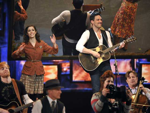 "Cristin Milioti, left, and Steve Kazee perform in a scene from ""Once"" at the 66th Annual Tony Awards on Sunday in New York."