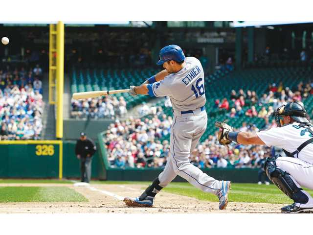 Los Angeles Dodgers outfielder Andre Ethier hits a grand slam against the Seattle Mariners on Sunday in Seattle.