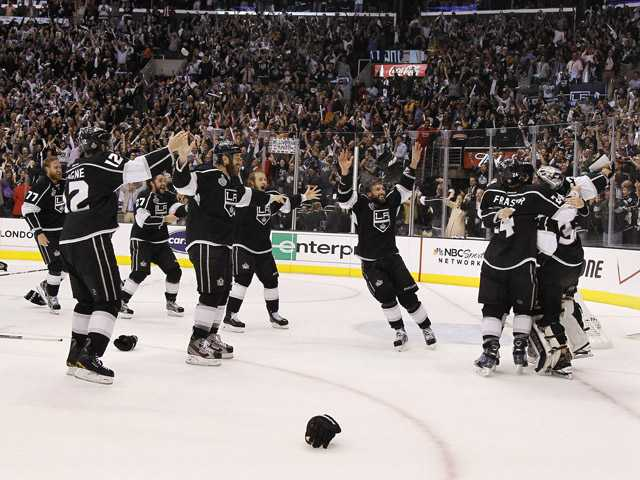 The Los Angeles Kings celebrate as time runs off the clock to beat the New Jersey Devils 6-1 during Game 6 of the NHL hockey Stanley Cup finals on Monday.