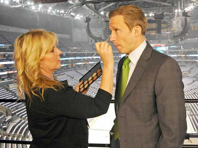 "Sally Van Swearingen touches up makeup on Liam McHugh, before Game 6 of the Stanley Cup Final at Staples Center in Los Angeles on Monday.  McHugh is a host on ""NHL on NBC."""