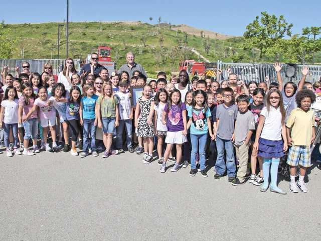 All of the third grade classes at Golden Oak Elementary school at their city assembly May 31 led by Mayor Frank Ferry. The class was one of the winners of a coloring contest.