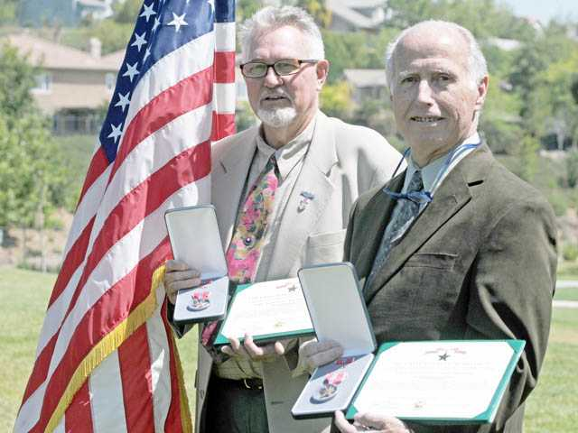 Vietnam veterans Bill Reynolds, left, and Stan Cockerell pose with their Bronze Star Medals, awarded at a ceremony at Jake Kuredjian Park in Stevenson Ranch on Monday.