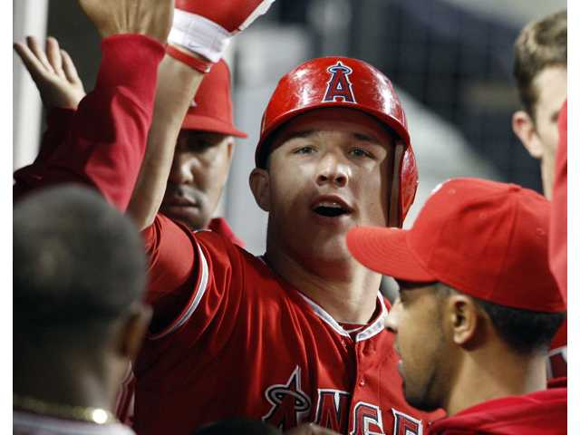 Los Angeles Angels outfielder Mike Trout and teammates celebrate his solo home run against the Los Angeles Dodgers in the fourth inning at Dodger Stadium in Los Angeles Monday.