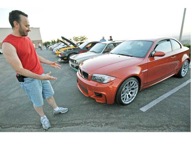Octavia Arreaza, of Valencia, discusses his 2011 BMW 1M coupe.