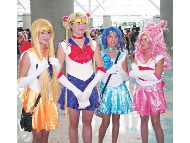 Elaborate costumes are the norm for Anime Expo. This group is dressed as Sailor Moon, second from left, and her friends. Some Anime Expo participants work on their costumes for nearly a year.
