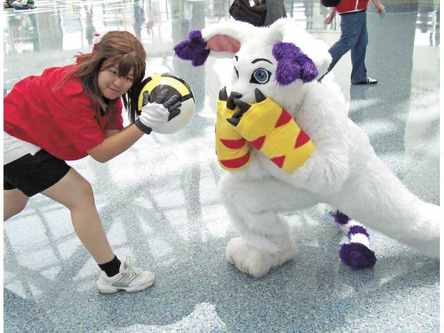 """Cosplay""   (costume play)— as well as posing for photos — is a popular activity at the Anime Expo."