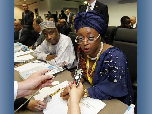 Nigeria's Minister of Petroleum Resources Diezani Alison-Madueke, right, speaks to journalists prior to the start of the meeting of the Organization of the Petroleum Exporting Countries, OPEC, at their headquarters in Vienna, Austria.