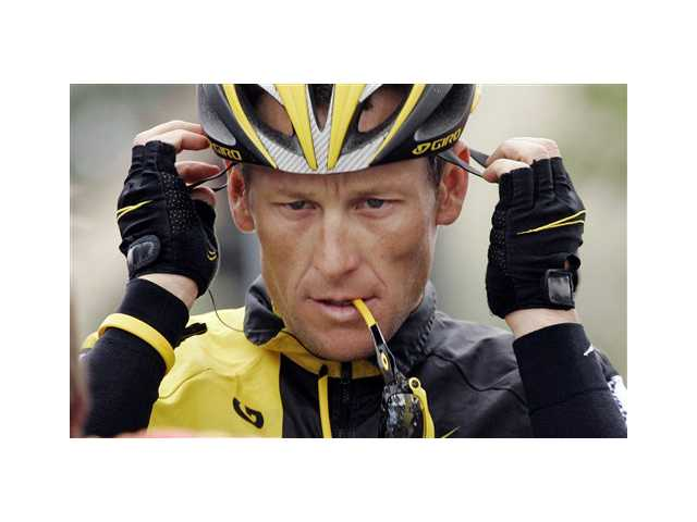 Lance Armstrong prepares for the final stage of the Tour of California cycling race in Rancho Bernardo in 2009.