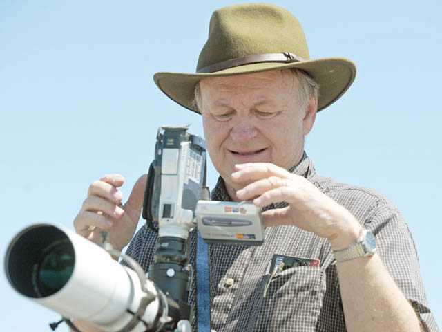 "Jim Van Winkle, of Granada Hills, sets up a camcorder on a telescope with a solar filter to record the Transit of Venus on the parking lot outside Babies ""R"" Us on Carl Boyer Drive in Santa Clarita on June 5."