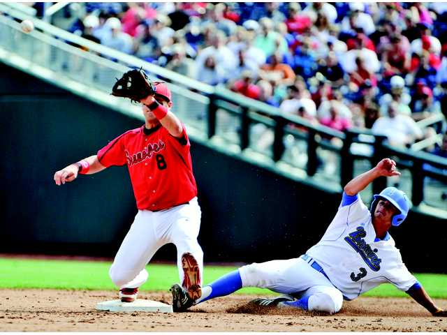 UCLA's Kevin Kramer (3) beats the throw to second baseman Maxx Tissenbaum (8), on a fielder's choice by Kevin Williams, in the first inning of an NCAA College World Series game in Omaha, Neb., on Friday.