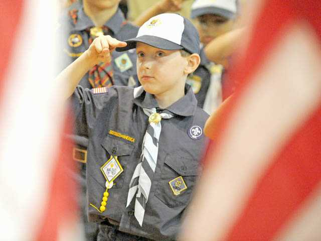 Cub Scout Christopher Kendig, 8, salutes the American flag during a Flag Day ceremony at the Santa Clarita Elks Lodge in Canyon Country on Friday.