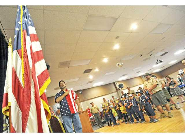 "Attendees sing ""The Star-Spangled Banner"" at a Flag Day ceremony at the Santa Clarita Elks Lodge in Canyon Country on Friday."