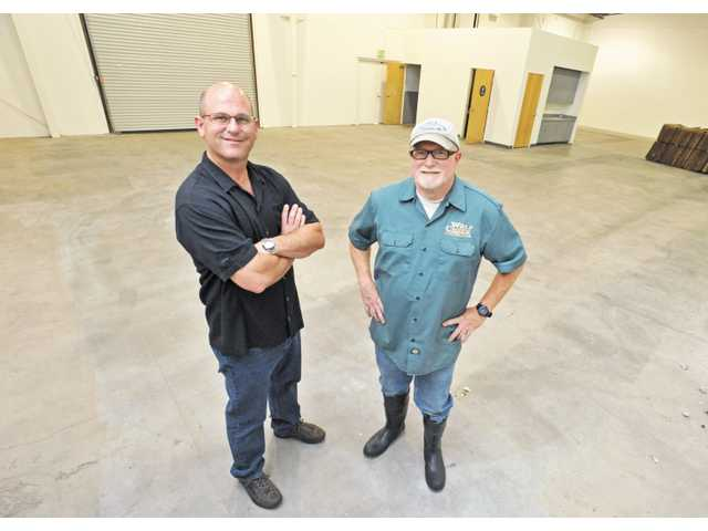 Partners Darren Utley, left, and Rob McFerren pose in the future site of Wolf Creek Restaurant & Brewing Co.'s new brewery in the Mann Biomedical Park in Valencia on Thursday.