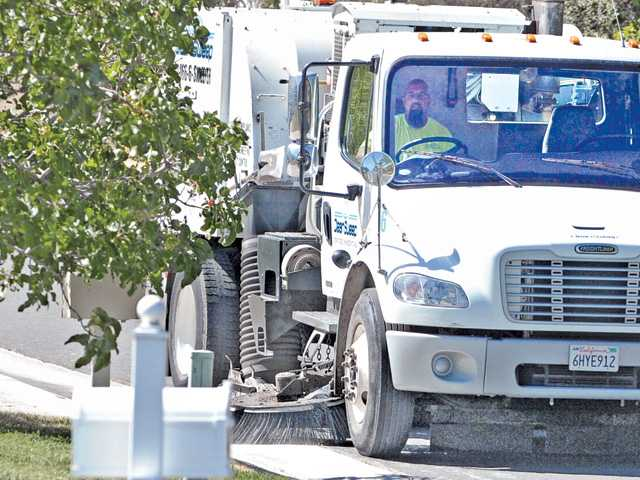 Jonathan Harding operates a street sweeper in Sand Canyon on Friday.