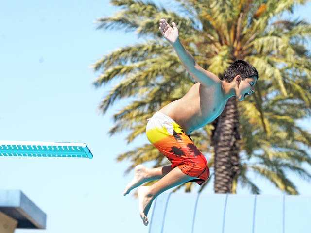 Lucas Forno, 12, launches into a pool at the Santa Clarita Aquatic Center on Tuesday. The city's pools are officially open. Check the-signal.com for their schedules.