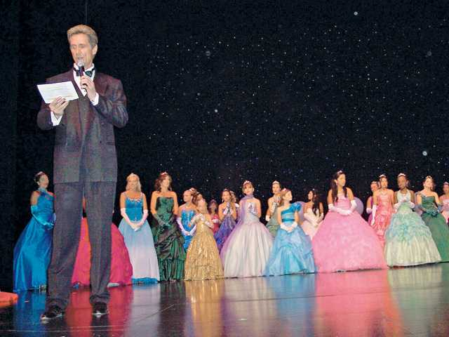 Emcee Alan Reno reads the names of the semifinalists during the Miss SCV Pageant.