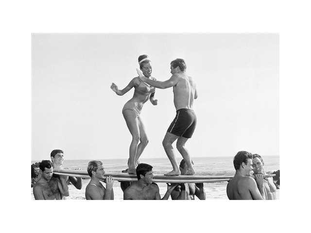 "Actors in a Hollywood movie dance ""the twist"" in Malibu, in a 1965 file photo. The Federal Reserve announced Wednesday, it is extending its ""Operation Twist"" program, which is named after the dance craze in an a nod to economic history."