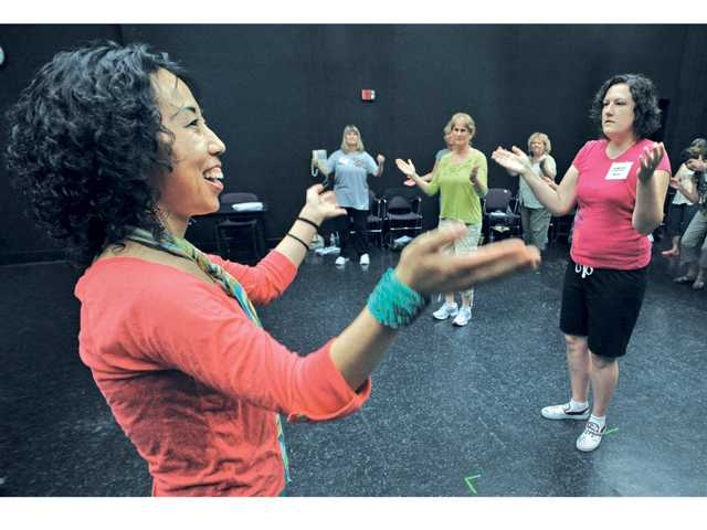 Hip-hop teacher Tiffany Bong, left, instructs educators as they participate in a hip-hop dance class at College of the Canyons, hosted by the Performing Arts Center in Valencia on Thursday, as part of the Santa Clarita Valley K-12 Arts Education Consortium's professional development summer training program.