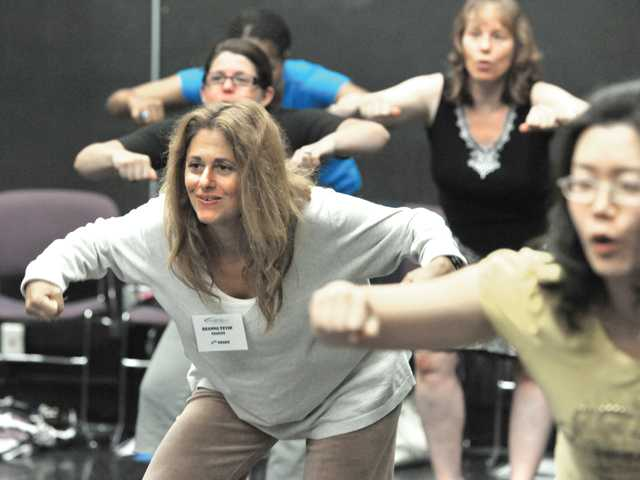 "Sixth-grade teacher Deanna Zevin, of Saugus, left, learns the ""bust"" move."