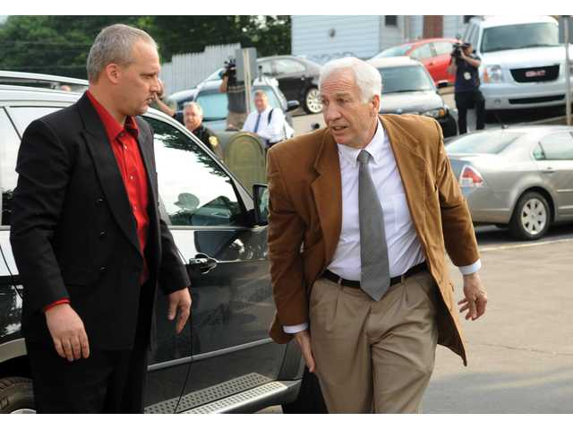 Former Penn State University assistant football coach Jerry Sandusky arrives at the Centre County Courthouse in Bellefonte, Pa., on Friday. Sandusky was convicted on 45 of 48 counts.