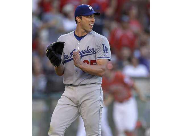 Los Angeles Dodgers starting pitcher Chris Capuano celebrates after Los Angeles Angel Torii Hunter flied out during Saturday's game in Anaheim.