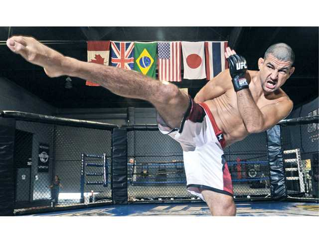 Mixed martial arts fighter Vinc Pichel trains at Big John McCarthy's Ultimate Training Academy on Friday in Valencia.