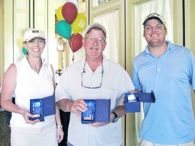 Members of the mixed team with the lowest score at Zonta's golf tournament include, left to right, Mic Montalvo, Mark David and Mike Miller. The mixed team actually turned in a lower score than the lowest men's team.