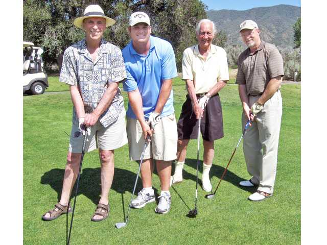 Contestants in the $100,000 shootout at Zonta's recent golf tournament include, left to right, Jim Lentini, Mike Miller, Mitch Davis and Jim Blazer. Although they missed the $100,000 hole-in-one, Blazer won a vacation package for closest to the pin and Mike Miller won second place. Men's Low Score winners were John Heys, Bob Kellar, Don Hinson and Jerry Wagmouth.