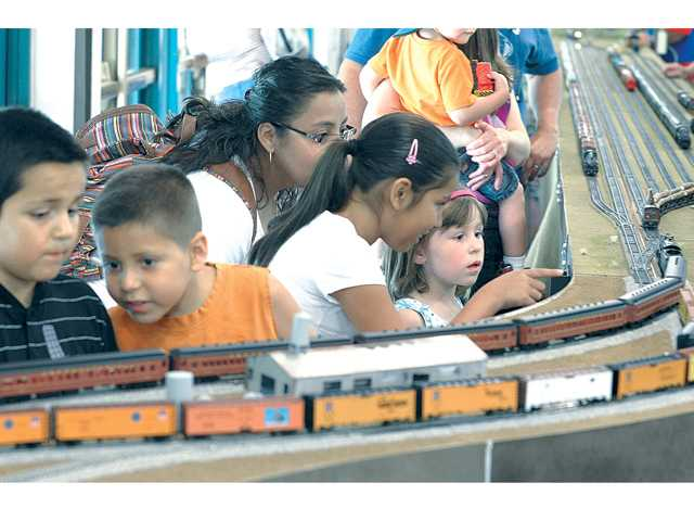 Claire Wilson, 6, right, points to a set of passenger cars as children watch.