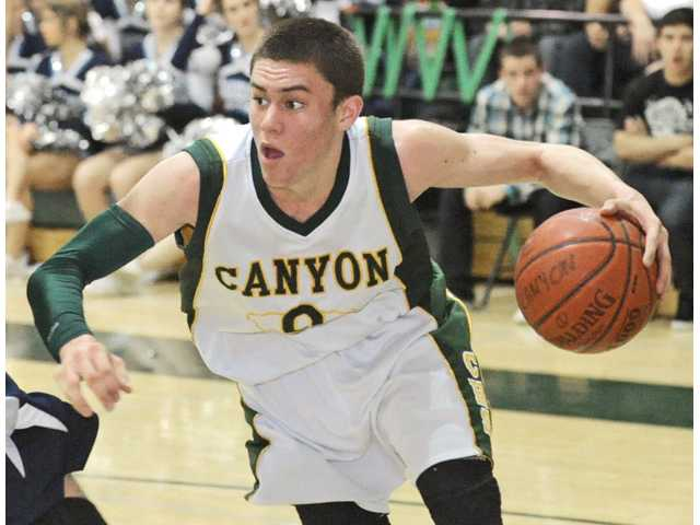 Canyon High senior boys basketball and football player Coley Apsay is the school's 2012 Male Athlete of the Year.