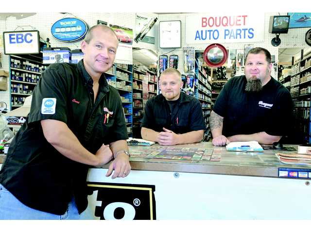 From left, Bouquet Auto Parts owner Owen Powell and salesmen Brett D'Elia and Dustin Miller pose in the Saugus store.