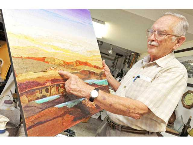 "Local artist Don Trout describes his painting ""Arizona Reflections."""