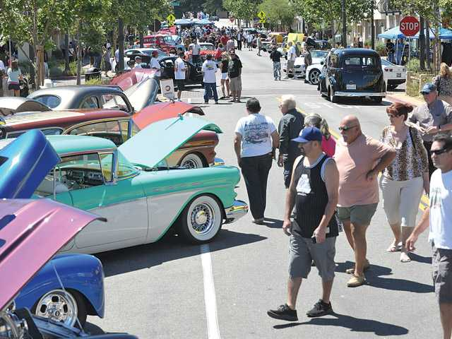 Dozens of pre-1957 cars line Main Street as hundreds of car enthusiasts roam the Old Town Newhall Car Show on Sunday.