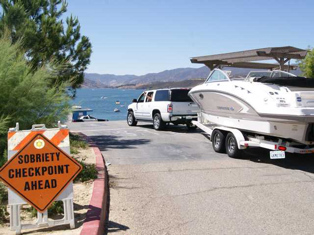 Boating enthusiasts arrive at Castaic Lake, where sheriff's deputies were conducting sobriety tests on boaters on Sunday.