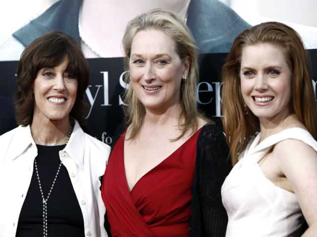 "Writer Nora Ephron, left, and cast members Meryl Streep, center, and Amy Adams pose together at the premiere of ""Julie and Julia"" in Los Angeles."