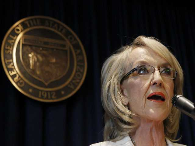 Arizona Gov. Jan Brewer speaks during a news conference about the United States Supreme Court decision regarding Arizona's controversial immigration law, SB1070, coming down at the Arizona Capitol on Monday,