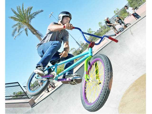 Micah Muskovich, 16, performs a Toboggan trick with his BMX bike at the Santa Clarita Skatepark on Friday afternoon.
