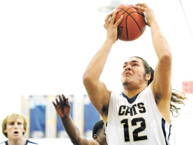 West Ranch basketball player Ako Kaluna was a dominant force in leading his team to one of the school's seven Foothill League championships in 2011-12.