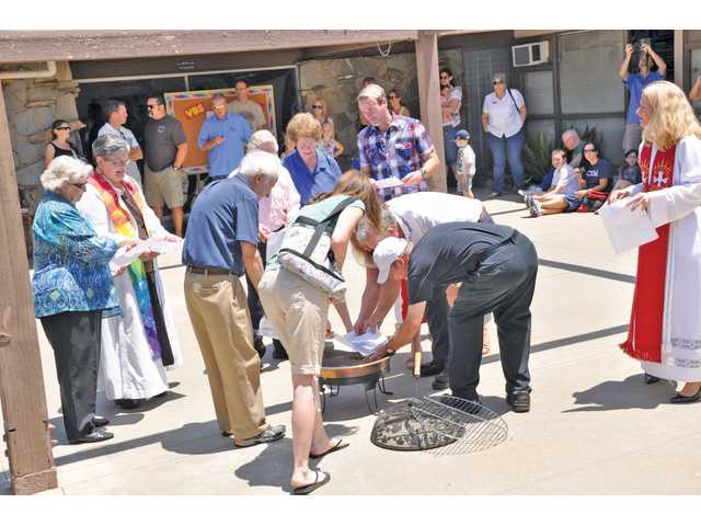 Members of the community join in a mortgage-burning celebration at Santa Clarita United Methodist Church.