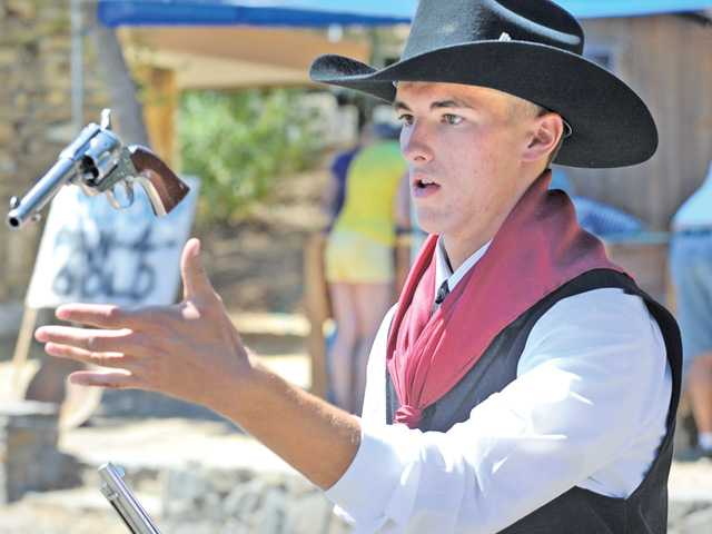 Tyler Houck, 17, of Canyon Country demonstrates his gun spinning skills at the inaugural SCV Wild West Days presented by the Santa Clarita Valley Historical Society at Heritage Junction next to William S. Hart Park in Newhall on Saturday