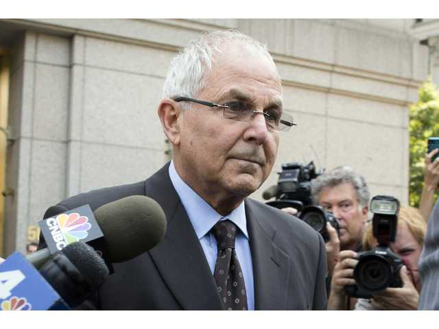 Peter Madoff leaves Federal Court on Friday, June 29, 2012 in New York after pleading guilty to criminal charges.
