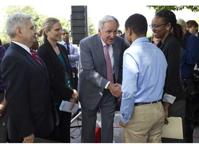 Sen. Jack Reed, D-RI, left, and Sen. Tom Harkin, D-Iowa, center, meet with college interns as they call for action on averting a July 1 doubling of interest rates on federal college loans for students.