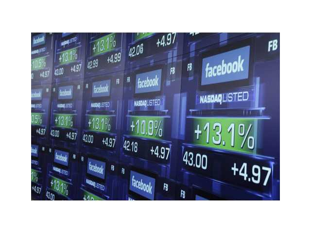 Electronic screens show the price of Facebook shares after they began trading in New York.