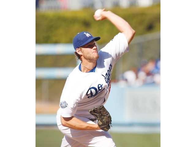 Los Angeles Dodgers starting pitcher Clayton Kershaw delivers a pitch in the first inning against the New York Mets in Los Angeles on Sunday.
