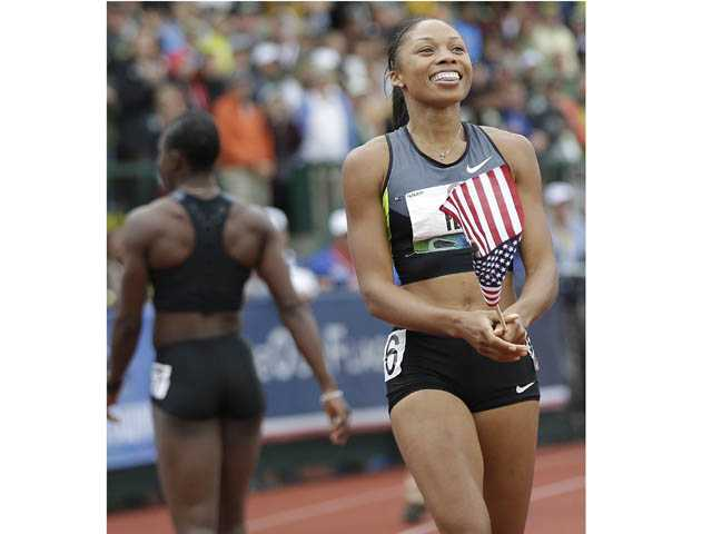 Santa Clarita Valley resident Allyson Felix, right, celebrates her win in the women's 200 meters at the U.S. Olympic Track and Field Trials in Eugene, Ore., on Saturday.
