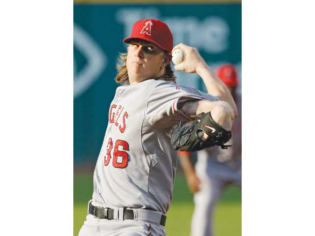 Los Angeles Angels starting pitcher Jered Weaver delivers against the Cleveland Indians in the first inning on Monday in Cleveland.
